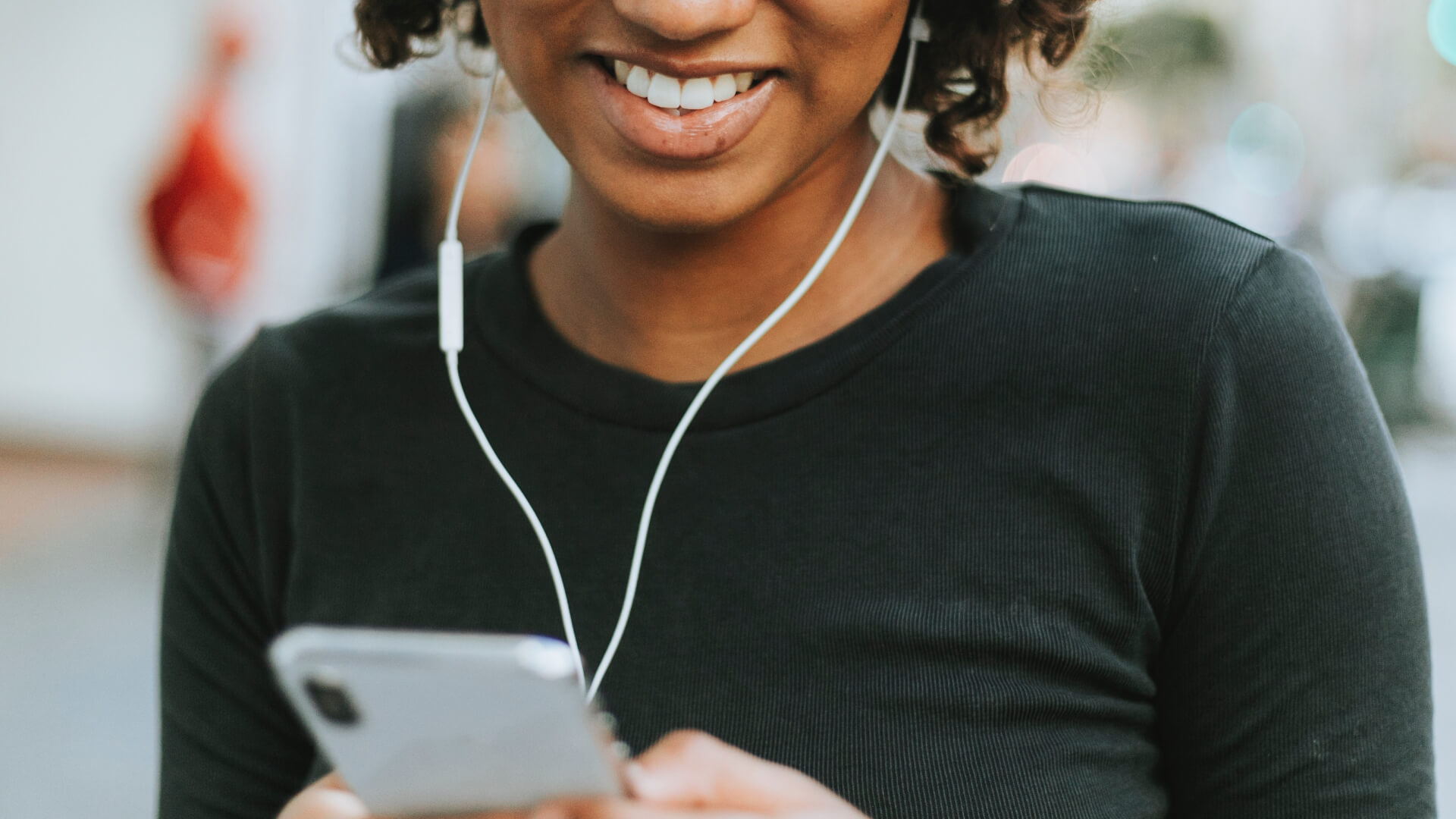 Smiling woman wearing earbuds